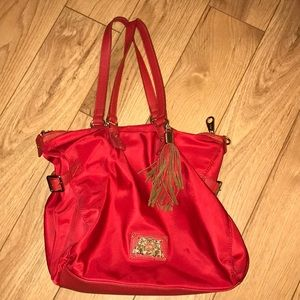 Red Juicy Couture purse with tassel
